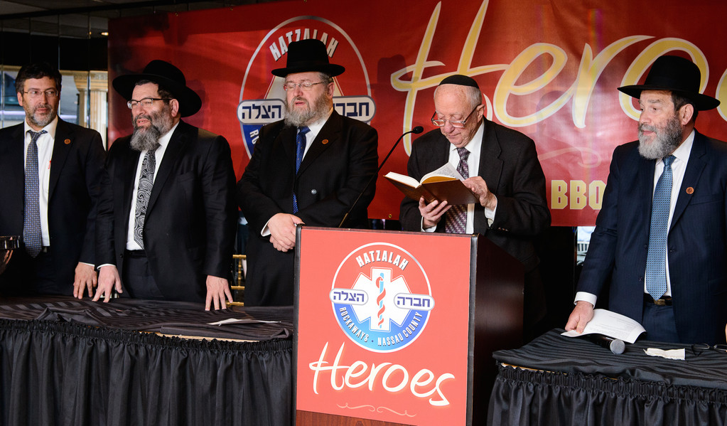 At Sunday's Hatzalah Heroes barbecuse (left to right): Mark Gross, Rabbi Yaakov Bender, Shaya Luzer Wolcowitz, Rabbi M. Lerer, Rabbi Elozer Kanner