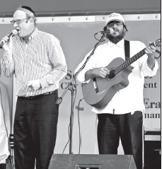 Simcha Weber with Yonatan Tzarum from Simpy Tsfat perform a song together.