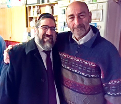 Rabbi Oppen is pictured in Copenhagen with the father of Dan Uzan, Hy