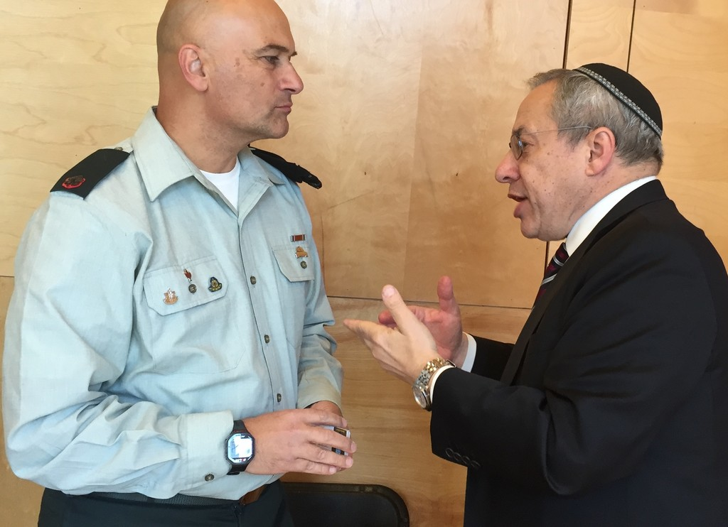 YIW Rabbi Hershel Billet speaks with Special in Uniform Director Tiran Attia on Sunday.