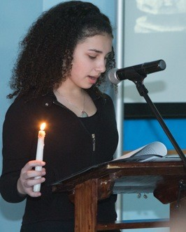 A HANC Middle School student held a memorial candle and spoke on Yom Hazikaron.