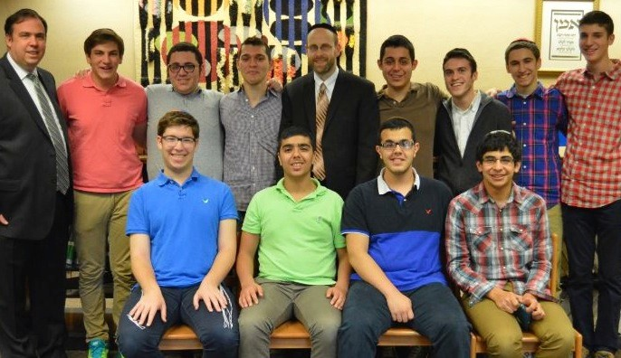 HANC CHAMPS. Standing from left: Rabbi Shlomo Adelman, David Schwartzman, Noah Livi, Michael Nassimi, Coach-Rabbi Shimon Chrein, David Aziz, Gideon Pollack, Matthew Rosenberg and Captain Ari Levine. Seated: Eric Lenefsky, Mordechai Balakhaneh, Jacob Kohanim and Eran Vaknin. Not shown: Dovid Chai Deil, Shlomo Amsellem,Yoni Eshaghzadeh, Adam Livi.