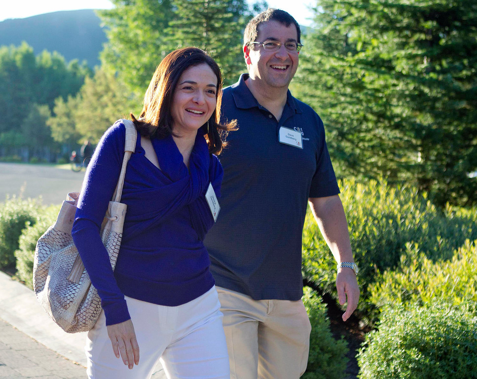 Facebook COO Sheryl Sandberg, left, and her husband, David Goldberg, CEO of SurveyMonkey, arrive at the Sun Valley Inn for a conference, in 2011.