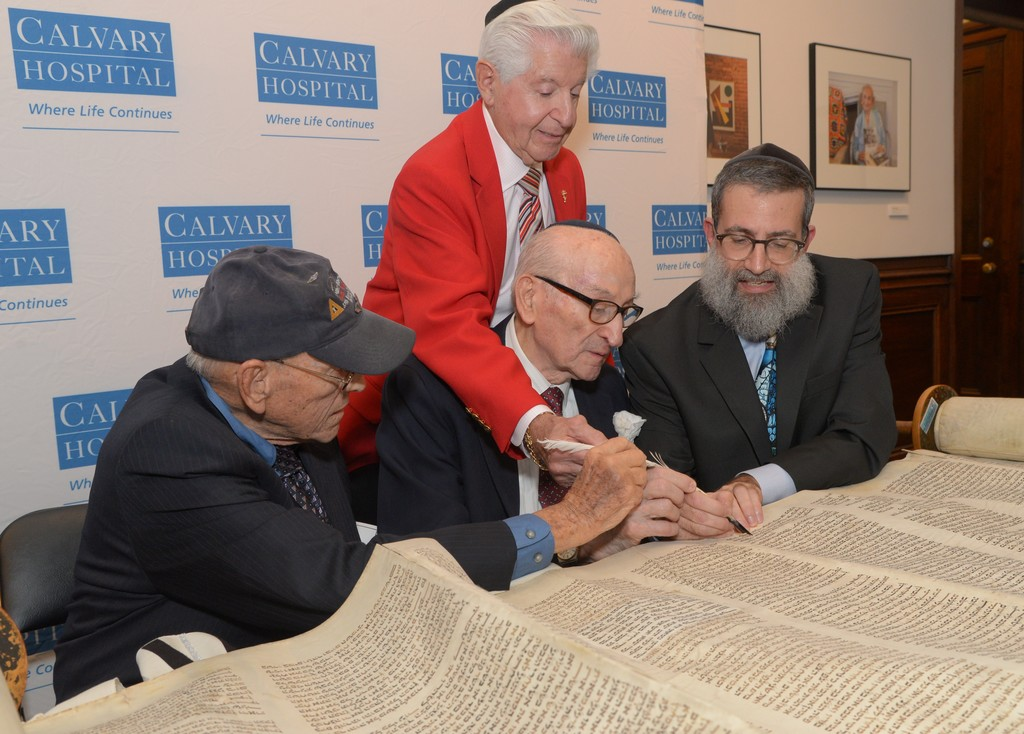 Attendees included three Jewish WWII Veterans and two Vietnam War veterans, congregants of Beth El Synagogue in New Rochelle. From left: Herb Perlman, Abe Walfish and Milt Mitler (standing) write a letter.