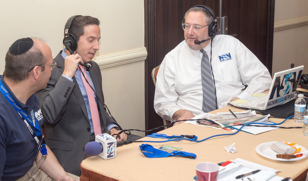 JM in the AM host Nachum Segal interviews Far Rockaway Assemblymember Phil Goldfeder, during a broadcast from Eldercare Plus.