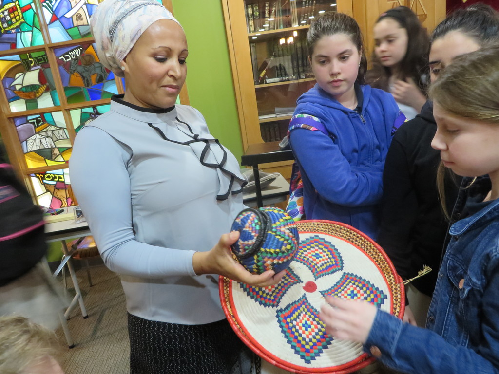 Rachel, who with her sister Anat walked months to leave Ethiopia and go up to Yerushalayim, spoke with HAFTR students and displayed crafts from their native land.