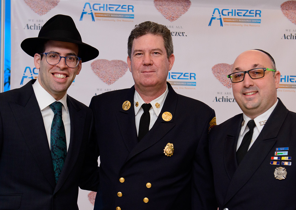 Rabbi Baruch Ber Bender with Lawrence Cedarhurst Fire Chief James Campbell and Moshe Bellesohn.