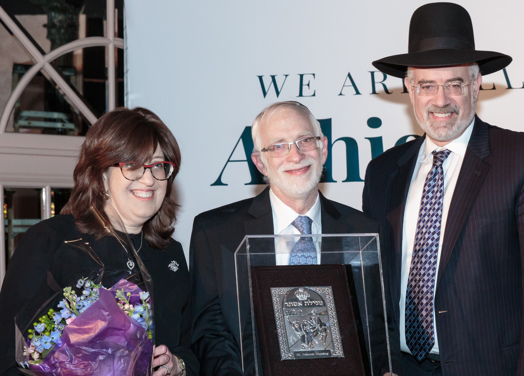 Esteemed Physician Appreciation awardee Dr. Deborah Dienstag with Avi Dienstag and Rabbi Moshe Teitelbaum of the Young Israel of Lawrence-Cedarhurst.