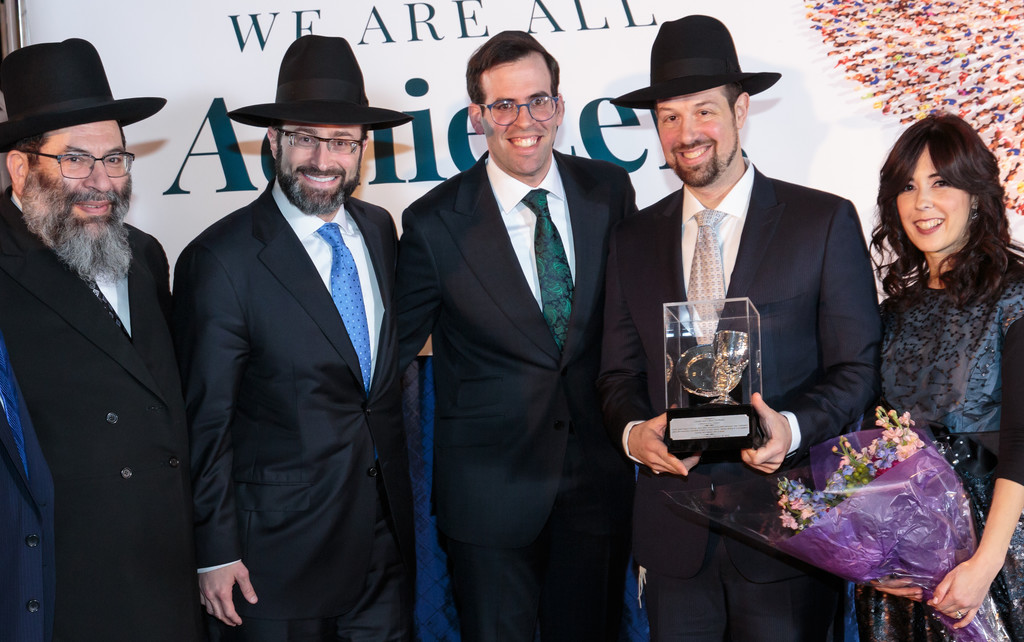 From left: HaRav Yaakov Bender, Rosh Yeshiva of Darchei Torah; Rabbi Eitan Feiner of the White Shul; Rabbi Baruch Ber Bender, pictured with Community Service Award honorees Eliahu and Chaia Frishman.
