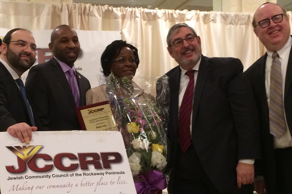 From left: xx, Rockaway Councilman xxxx, Public Service Award recipient Betty Leon, xxx, and xx.