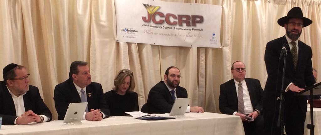 "From left: Rabbi Eytan Feiner of Keneseth Israel (The White Shul) in Far Rockaway, delivers a divar Torah about leadership. JCCRP Treasurer Shalom Becker, state Senator Joseph P. Addabbo, Queens Borough President Melinda Katz, JCCRP Executive Director Nathan Krasnovsky, NYC Comptroller Scott M. Stringer; NYC Public Advocate Leticia ""Tish"" James, and Public Service Award recipient Betty Leon."