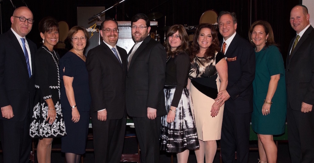 Pictured at KULANU's recent scholarship dinner, held in the Sephardic Temple, are Jeffrey Schoenfeld, president of the board of KULANU; Melodie Scharf, KULANU dinner chair; Beth Raskin, executive director of KULANU; Jay Goldmark, Marc and Adeena Penner, Shari and David Shapiro, and Nanci Freiman and Charlie Hammerman.