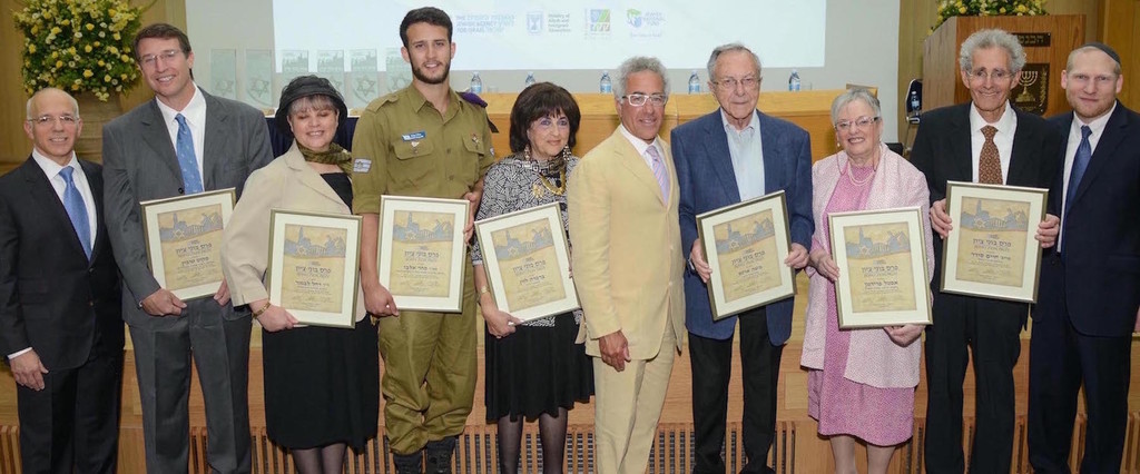 From left: NBN chairman and co-founder Tony Gelbart, Scott R. Tobin; Dr. Rachel Levmore, IDF Staff Sgt. (res.) Sahar Elbaz, Barbara Levin, Sylvan Adams, Moshe Arens, Estelle Friedman, Professor Howard (Chaim) Cedar, and NBN Co-founder and Executive Director Rabbi Yehoshua Fass.