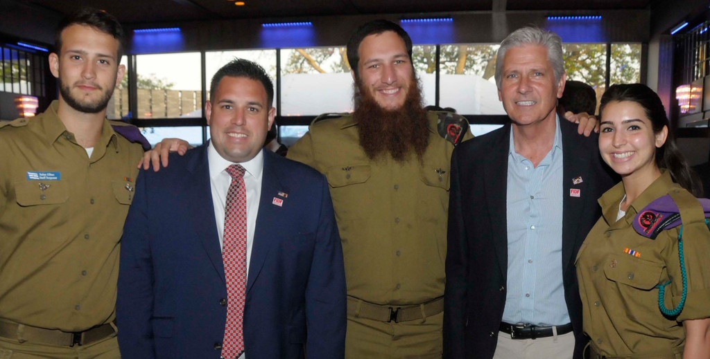 Hempstead Councilmen Bruce Blakeman and Anthony D'Esposito greeting Israelis solidiers at the FIDF Five Towns event. From left: IDF Staff Sgt. (Res.) Sahar, D'Esposito, IDF Cpl. Zalman, Blakeman, and IDF Sgt. Karen.