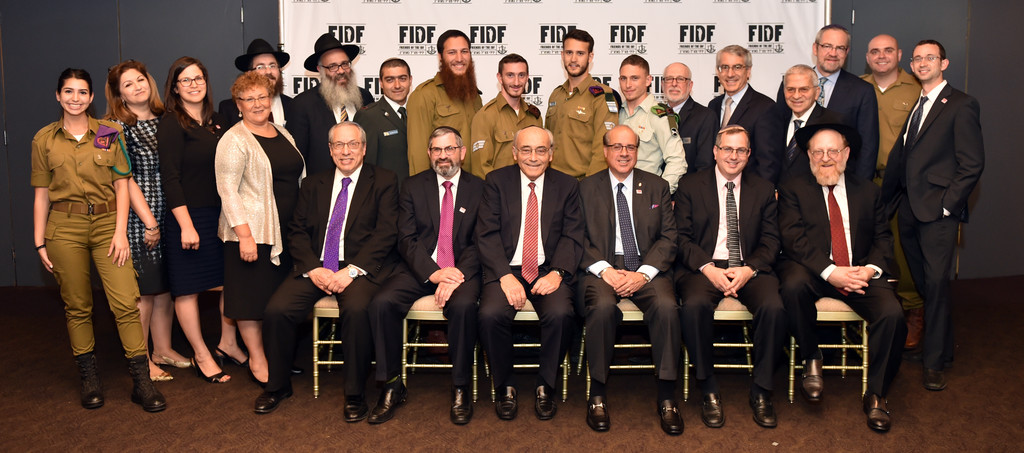From left, standing: IDF Sgt. Karen; FIDF Tri-State Executive Director Galit Brichta; FIDF Long Island Director Liron Kreitman; Miriam Peretz; Rabbi Yisroel Freedman, Rabbi Zalman Wolowik; Assistant Defense Attache at the Israeli Embassy in the U.S. Maj. Shlomi Weizman; IDF Cpl. Zalman; IDF Staff Sgt. Chanan; IDF Staff Sgt. (Res.) Sahar; IDF 1st Lt. Daniel; Rabbi Elliot Skiddell; Rabbi Bruce Ginsburg; Rabbi Sholom Stern; Rabbi Kenneth Hain, IDF Sgt. (Res.) Shai; and Rabbi Yaakov Trump. From left, sitting: Rabbi Hershel Billet; Rabbi Zev Freidman, Rabbi Arnold Marans; Rabbi Jay Rosenbaum; Rabbi Ira Ebbin; and Rabbi Meshy Blumstein.