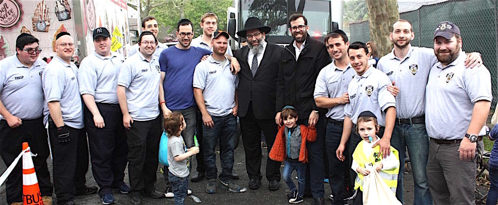 Pictured are RNSP volunteers and (near center) Rabbi Yaakov Bender, Darchei Torah's Rosh HaYeshiva, and his son Rabbi Baruch B. Bender, founder and president of Achiezer.