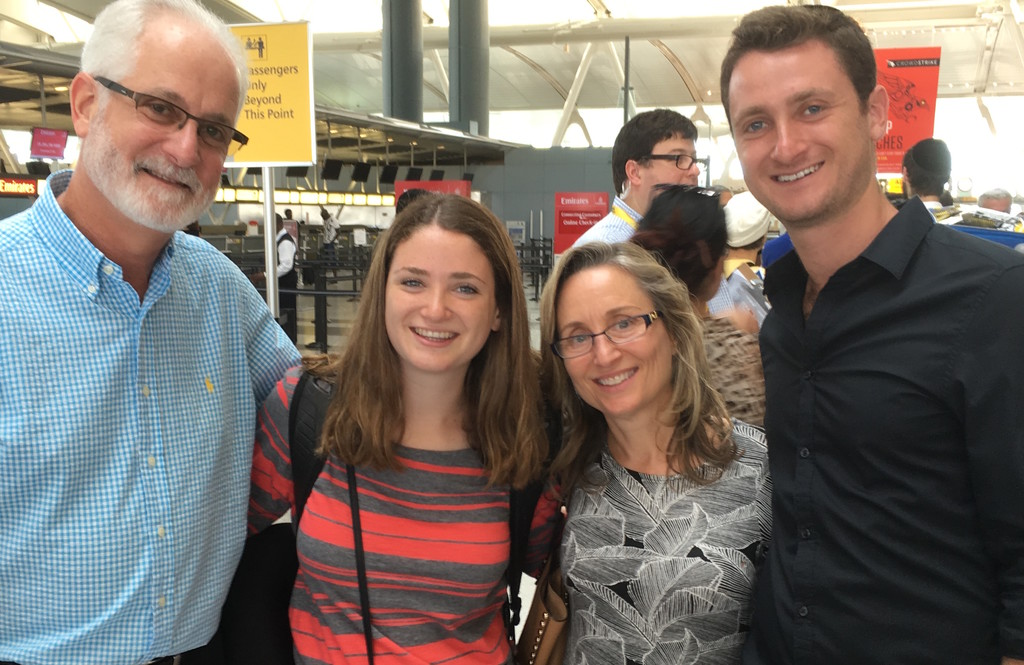 Jessica Kane of Great Neck.is waiting to board Tuesday's Nefesh B'Nefesh charter flight at JFK. Seeing her off are her proud parents, Andrew and Debbie Kane, and her brother, Max (right). Max made aliyah in 2011.