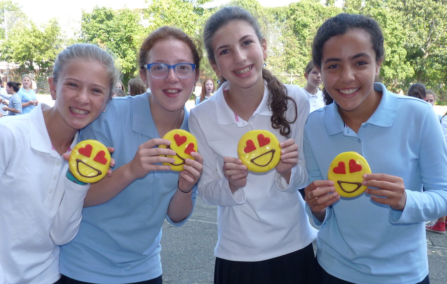 At the Shulamith School for Girls in Cedarhurst, the smiles are on the girls' faces as well as their cookies. From left: Shaked Harari, Shayna Wasser, Rachel Schwartz and Lily Paritzky.