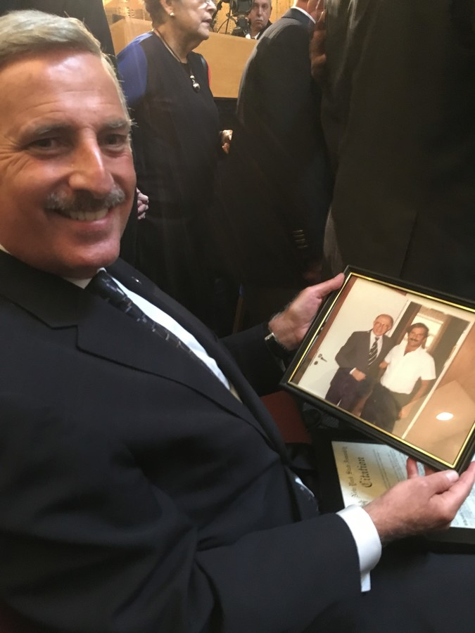 Queens Assemblyman David I. Weprin brought a photo that pictures him with Israeli Prime Minister Menachem Begin in 1981. Begin was referenced by several speakers, in anticipation of his upcoming 25th yahrzeit.