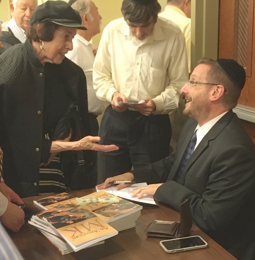 Rabbi Dov Lipman signs his book following a talk in Jamica Estates.