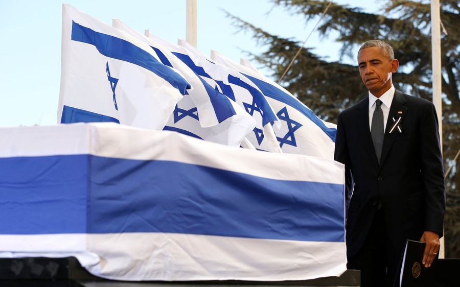 President Obama touches the coffin of former Israeli president and prime minister Shimon Peres after speaking during his funeral at Jerusalem's Mount Herzl national cemetery on Sept. 30.