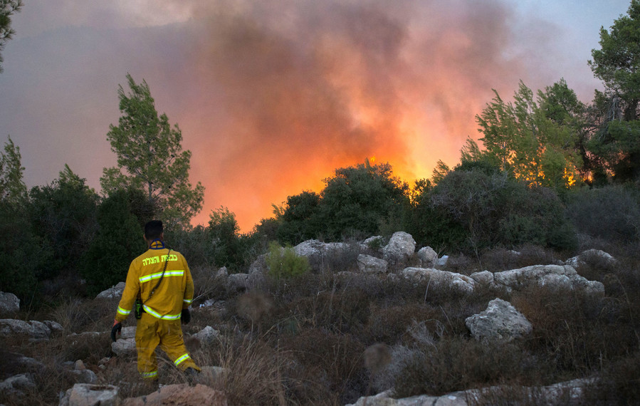 Fire fighters try to extinguish a wildfire which broke out iat the entrance to Nataf, outside of Jerusalem on Nov. 25.
