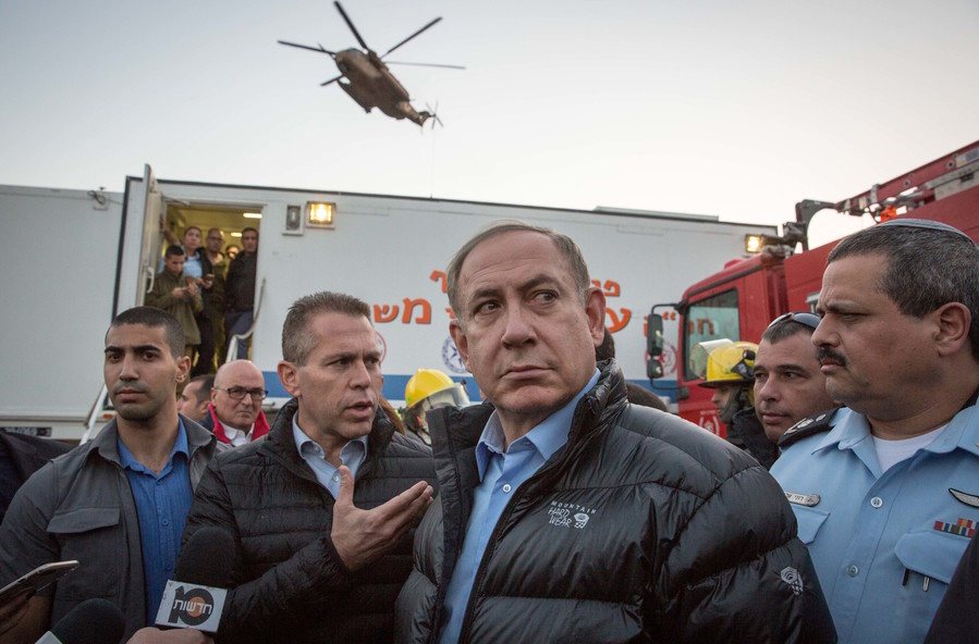 Prime Minister Benjamin Netanyahu visiting the scene of a fire in Zichron Yaakov, in northern Israel, last Wednesday.