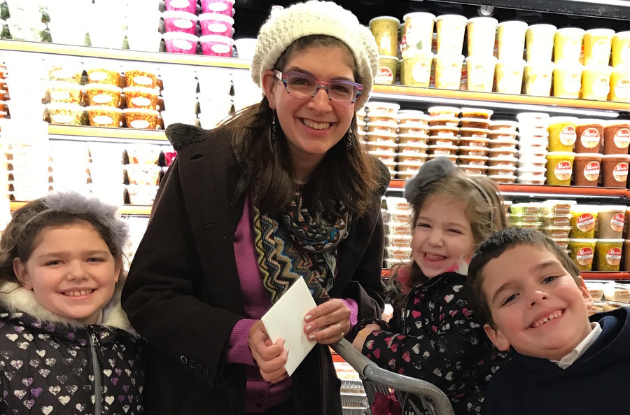 Esther Lejbovitz of Far Rockaway, with Shaina, 8, Meira, 3, and Yaakov, 7, won a $500 shopping spree at Seasons in Lawrence.