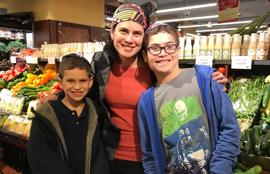Naomi Ostrow of Woodmere, with Ethan, 19, and Matthew, 12, was the winner of a $500 in groceries from Seasons in Lawrence.