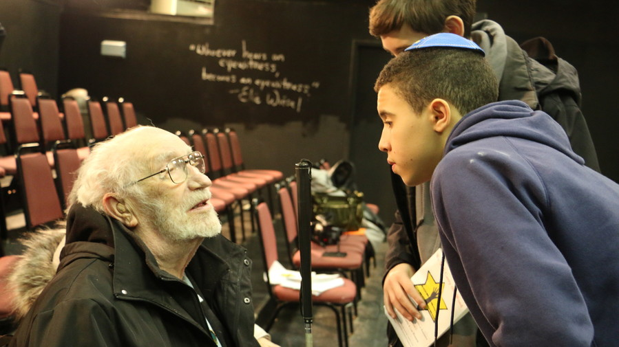 MDS students Benjamin Platovsky and Max Jankelovits speak to Holocaust survivor, Benjamin Wayne.