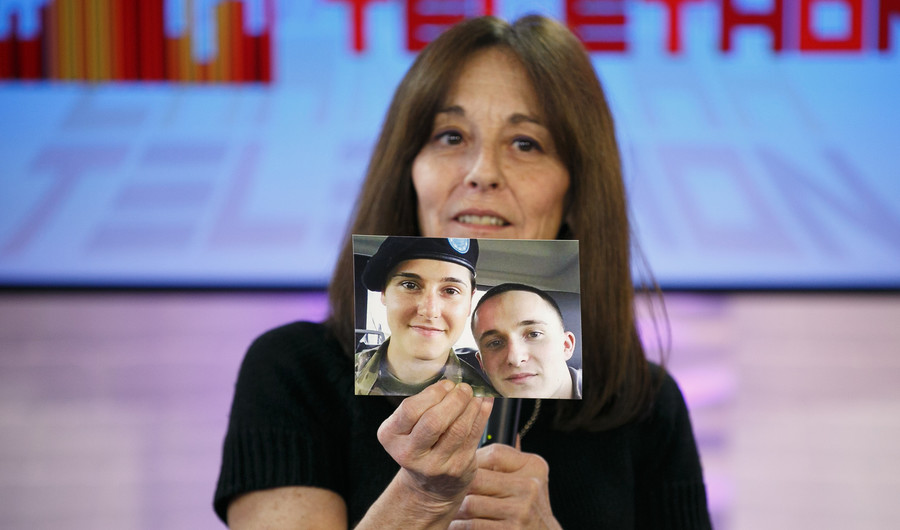 Linda Alogna told how she saved her son, whose picture she's holding, from a heroin overdose with use of Narcan