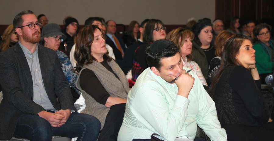 An audience made up predominently by members of the Orthodox community listens intently to a discussion on addiction, at the Woodmere firehouse on Dec. 14.