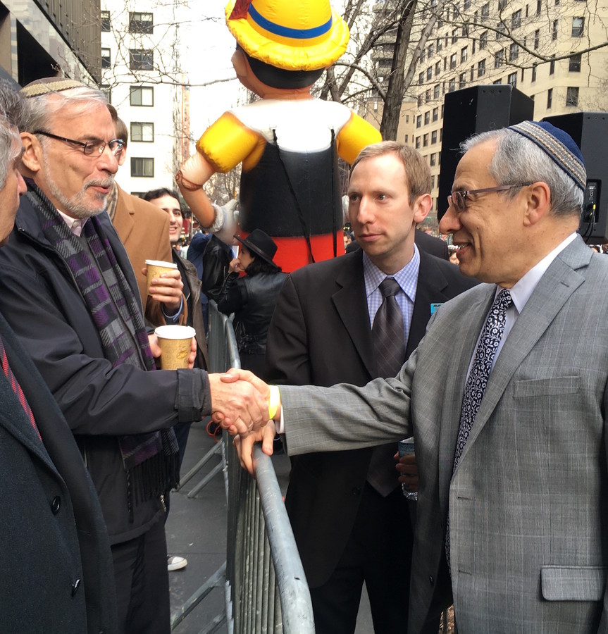 Rabbi Hershel Billet of the Young Israel of Woodmere greets Boro Park Assemblyman Dov Hikind at Thursday's protest outside the French mission to the U.N. in Midtown Manhattan as Avi Posnick of StandWithUs looks on.