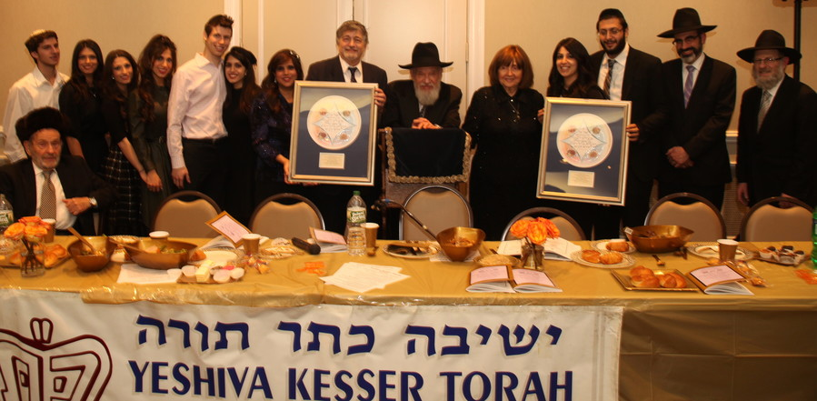 "Rosh HaYeshiva Rabbi Elyakim G. Rosenblatt (center) feted Guests of Honor Dr. Paul and Drora Brody of Great Neck (holding plaque to his left) and Yaniv and Leora Meirov (holding plaque to his right) for the respective couples' dedication and devotion to the yeshiva. From left, the ""Brody Bunch"" consisting of Joey, Dana, Limor and Liat Brody, Judah and Tali (Brody) Spector, Drora and Dr. Paul Brody, Rav Rosenblatt, Rebbitzen Trani Rosenblatt, Leora and Yaniv Meirov, Guest Speaker, Rabbi Shmuel Marcus of the YI Queens Valley, and Rabbi Aryeh Sokoloff of Adas Yeshurun, Kew Gardens Synagogue. Rabbi Nosson Farber is seated at left."