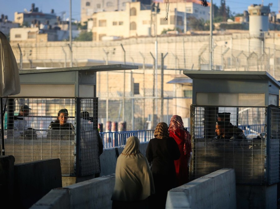 Palestinians cross the Qalandiya checkpoint, outside of Ramallah.