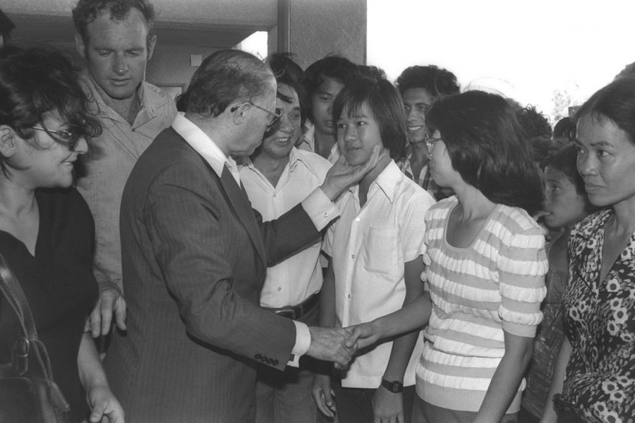 Prime Minister Menachem Begin greets Vietnamese refugees who were absorbed in Afula, June 26, 1980.