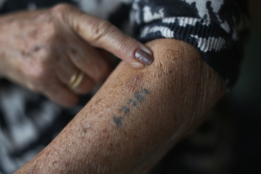 Auschwitz and Belsen concentration camp survivor Eva Behar shows her number tattoo.