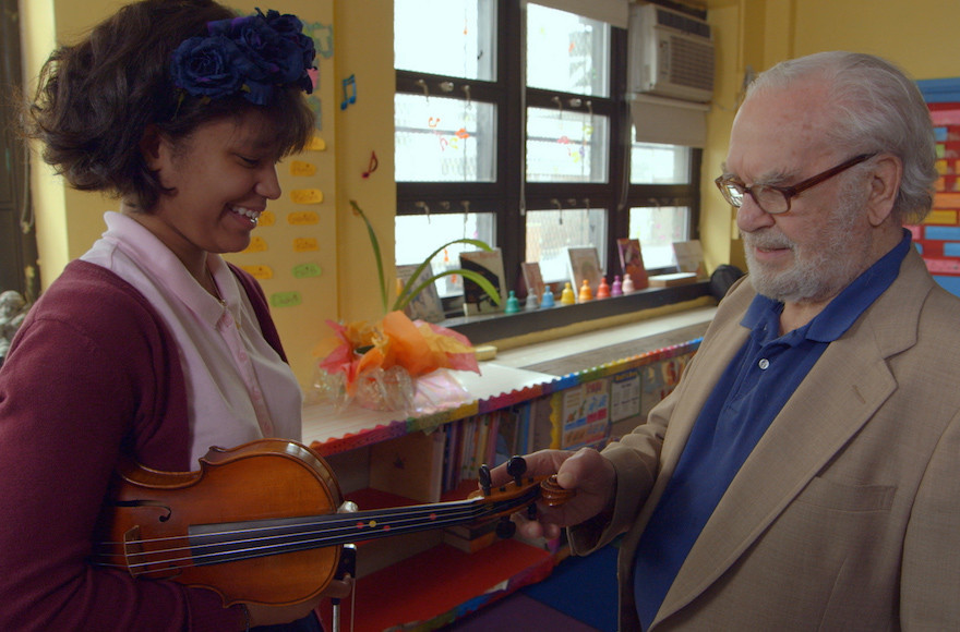 "Joe Feingold and Brianna Perez in the Oscar-nominated short documentary ""Joe's Violin."""