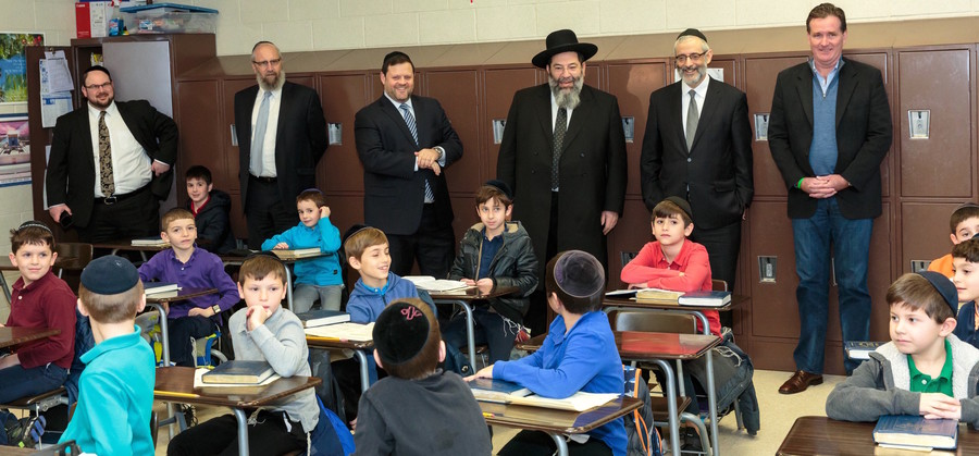 In a Darchei classroom (from left): Rabbi Baruch Rothman, Darchei's director of institutional advancement; Yeruchem Silber, a member of Agudath's Vaad Hanhalah and executive director of the Boro Park Jewish Community Council; Chaskel Bennet, member, Agudath board of trustees; Rabbi Yaakov Bender, Darchei rosh ha yeshiva; Rabbi Chaim Dovid Zwiebel, Agudath executive vice president; state Senate Majority Leader John Flanagan.