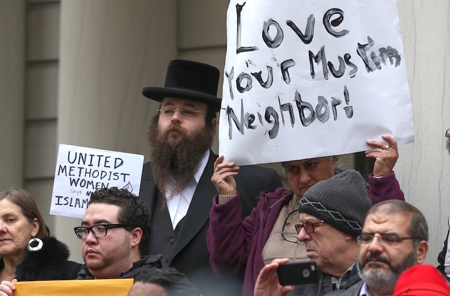 Alexander Rapaport, attending a protest at NY City Hall last December after candidate Donald Trump called for a ban on Muslims entering the U.S.