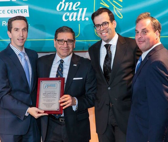 James Vilardi was recognized for his help in facilitating the meeting of requiremenets for converting the former BestBuy space into Sunday night's gala. He's flanked by former Far Rockaway Assemblyman Phillip Goldfeder (left), and Achiezer Founder and President Rabbi Boruch B. Bender and Achiezer Chairman Shulie Wollman.