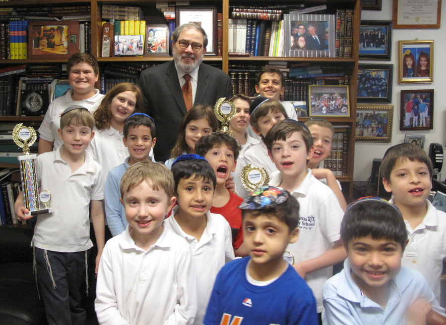 Rabbi Mordechai Besser with MDS Chess Tournament winners in 2016.