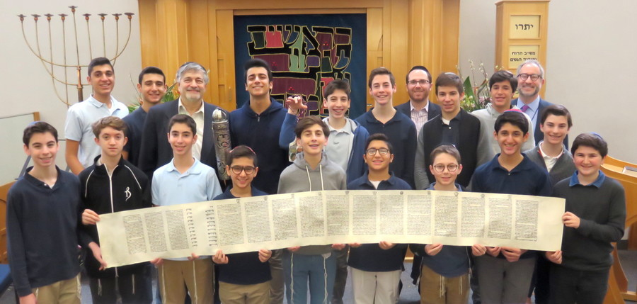 NSHA students prepared to read Megillat Esther with Dr. Paul Brody (back row, third from left, holding Megillah case); Rabbi Adam Acobas, Middle School principal (back row, fourth from right), and Rabbi Jeffrey Kobrin, head of school (back row, at far right).