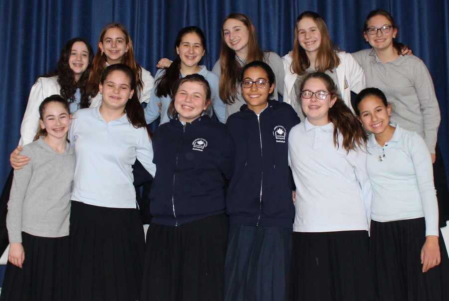 Shulamith Spelling Bee winner is Haley Rosenberg, bottom left, and runner up, Jenny Lifshitz, top row, second from left.
