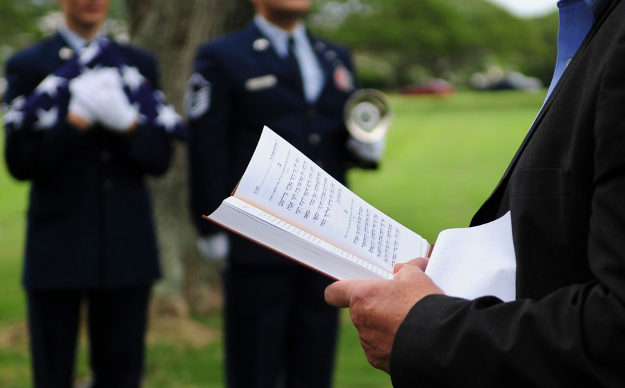 Daniel Bender, leader at the Lay Aloha Jewish Chapel, reads the Kelma'male Rachamim prayer during a memorial service for Staff. Sgt. Jack Weiner.
