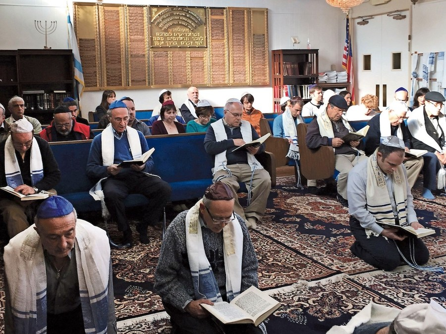 It is a custom among Karaite Jews to pray kneeling on the ground, as seen here in the sanctuary of Congregation B'nai Israel in Daly City, Calif.