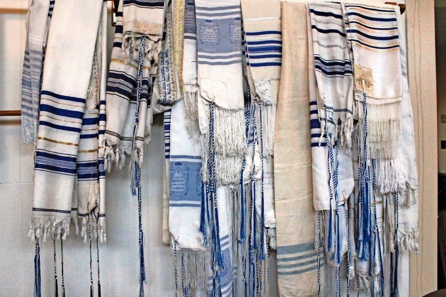 A rack of tallitot at Congregation B'nai Israel shows the unique style of tzitzit used by Karate Jews.