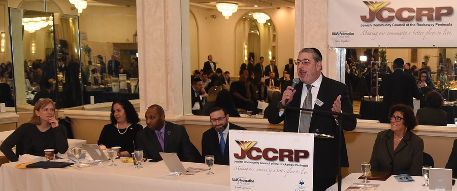 Richard Altabe, board chair of the Jewish Community Council of the Rockaway Peninsula, addresses Sunday's legislative breakfast, flanked (from left) by Queens Borough President Melinda Katz, Assemblymember Stacey Pheffer Amato, City Councilmember Donovan Richards, Rabbi Eytan Feiner, and Queens County Clerk Audrey Pheffer.