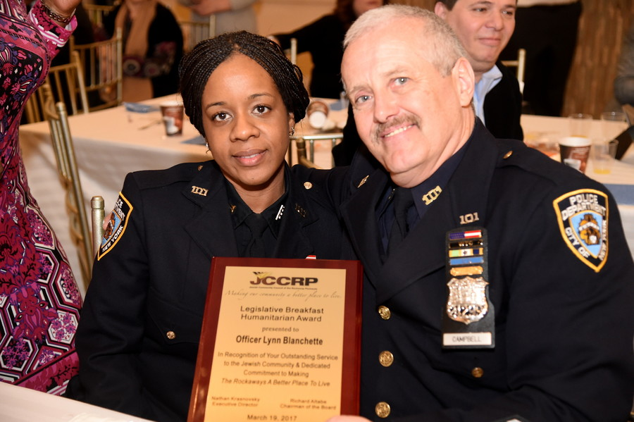 Lynn Blanchette, Community Affairs Officer of Far Rockaway's 101st Precinct, who received the JCCRP's Humanitarian Award, is pictured with Police Officer Kevin Campbell.
