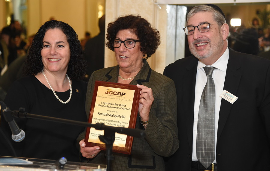 Assemblymember Stacey Pheffer Amato presents the JCCRP's Lifetime Achievement Award to her mother, former Assemblymember and current Queens County Clerk Audrey Pheffer, as JCCRP Board Chair Richard Altabe looks on.